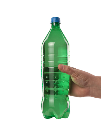 a green plastic bottle with a drink held in your hand Stock Photo