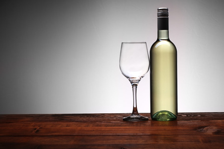bottle of wine with goblet on a white background