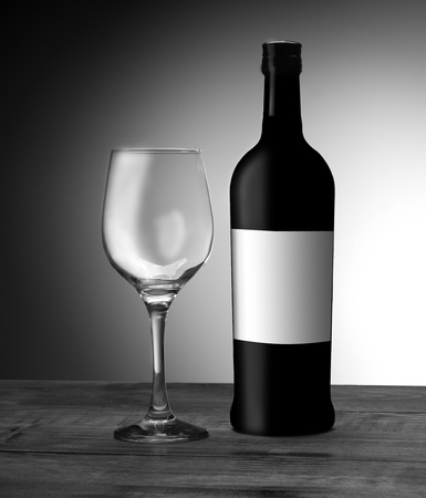 a bottle of wine with an empty glass on a white background Archivio Fotografico - 115434729