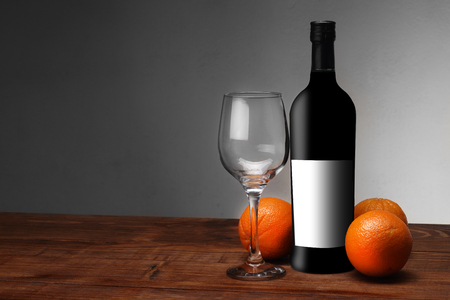wine with oranges and a glass on a white background Stock Photo