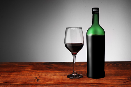 red wine with a glass on a white background