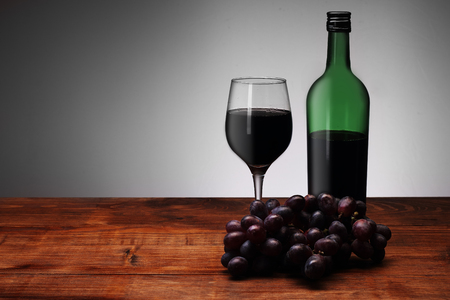 red wine with a glass and grapes