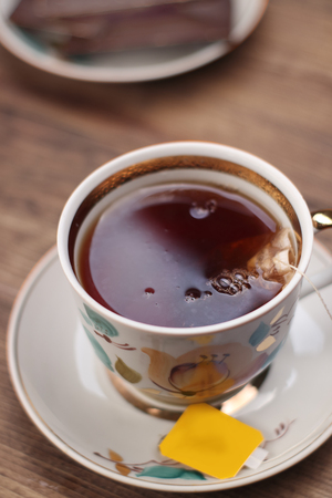a cup of tea on a table from boards Stock Photo