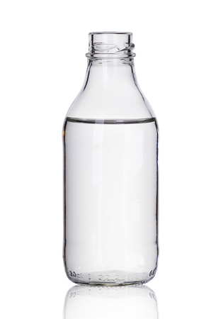 small glass bottle with liquid on a white background Stock Photo