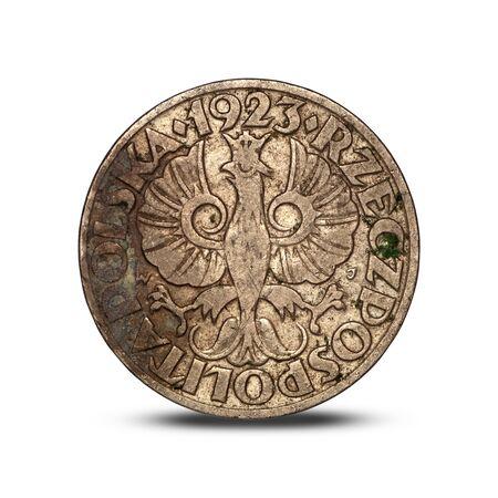 Polish interwar 20 groszy coin with an eagle on a white background