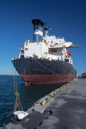 A cargo ship docked in the port photo