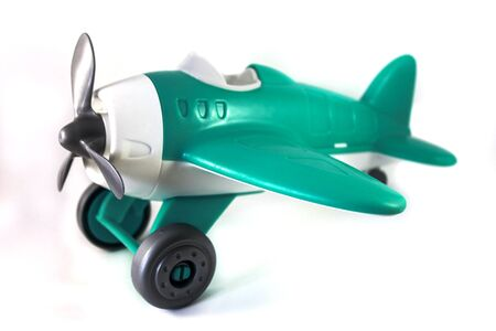 toy airplane with a propeller without a pilot on a white background