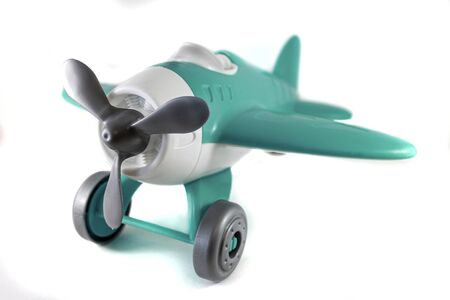 toy airplane with a propeller, on wheels, azure, white, gray, without a pilot