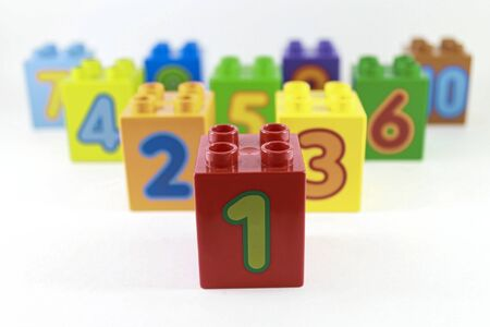 multi-colored plastic constructor with numbers 1, 2, 3 ... and 10 are arranged one after another in descending order. The development of young children. White background. Stok Fotoğraf