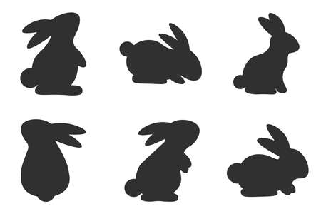 Set of silhouettes of gray rabbits isolated on a white background. Collection of rabbits in different poses. Easter Bunny. Vector illustration. Vettoriali