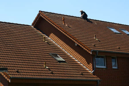Roofer at work on the roof