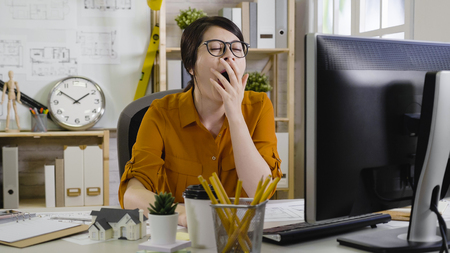 sleepy tired overworked hardworking assistant architect yawning with close eyes cover mouth want to sleep. Stock Photo