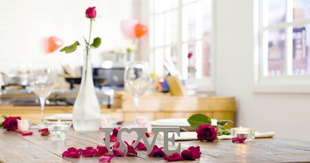 Festive table setting with love letter and flowers in vase glass for Valentine Day.