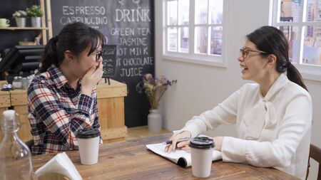 Job interview in cafe concept. young woman having conversation with hr manager in restaurant.