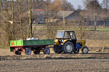 harrowing: The photo shows a tractor during the spring field activities
