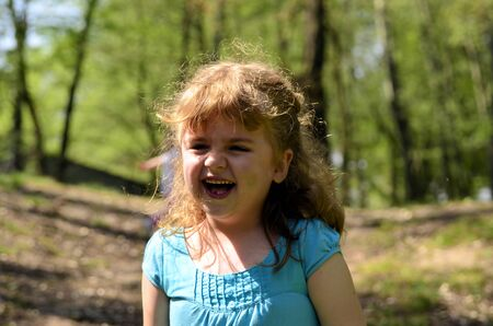 The photo shows a happy, smiling and joyful girl in the park Stock Photo - 13606872