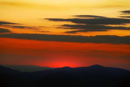 sunset on mountains photo