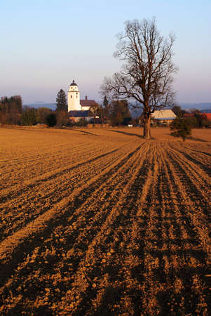 evening view - broke field and netin village in bohemian and moravian highland czech republic  Stock Photo - 12741061