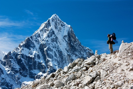 upland: hiker on mountains - hiking in Nepal - way to everest base camp