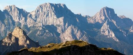 alpen: morning view from Karnische Alpen or Alpi Carniche to Alpi Dolomiti - Mount Siera, Creta Forata and Mont Cimon - Italy