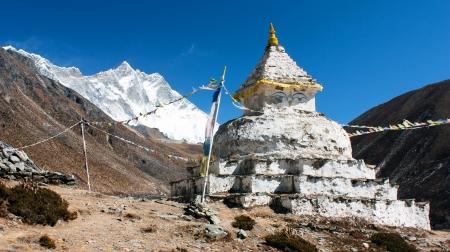 buddhist stupa with mount Lhotse - way to everest base camp  Stock Photo - 15305542