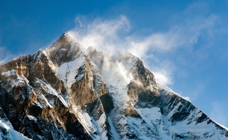 windstorm: evening view of Lhotse with windstrom and snow clouds on the top