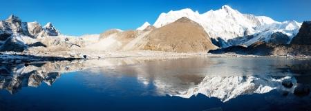view of Cho Oyu mirroring in lake - Cho Oyu base camp - Everest trek - Nepal Stock Photo - 17162004