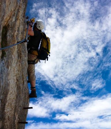 alpinist: alpinist on the via ferrata or klettersteig - extreme sport in Austria or Italy