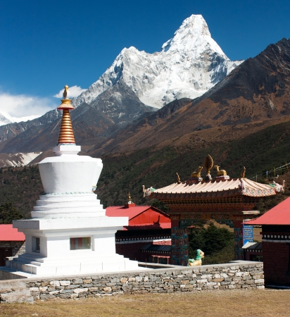 Stupa in Tengboche monastery with mount Ama Dablam on the way to Everest base camp  photo