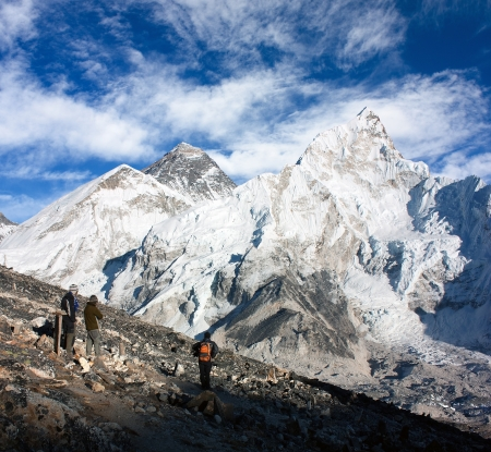 icefall: tourist watching Mount Everest from Kala Patthar view point - Nepal