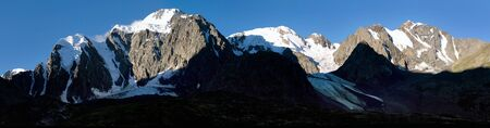 evening view of panoramic view of savlo rock face - altai range - mountains russia