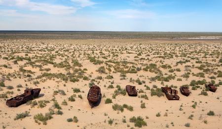 Boats in desert around Moynaq, Muynak or Moynoq - Aral sea or Aral lake in Uzbekistan