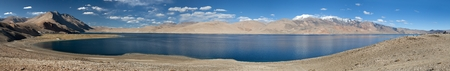 panoramic view of Tso Moriri lake, Korzok village and mounts Chamser Kangri and Lungser Kangri, India photo