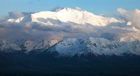 Evening view of Lenin Peak from Alay range - Kyrgyz Pamir Mountains in Kyrgyzstan and Tajikistan border photo