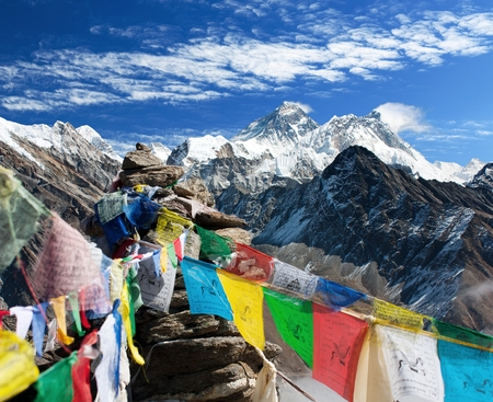 view of everest from gokyo ri with prayer flags - Nepal Stock Photo