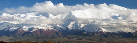 highlands region: Panoramic view of Lenin Peak from Alay range - Kyrgyz Pamir Mountains - Kyrgyzstan and Tajikistan border- Central Asia  Roof of the World   Stock Photo