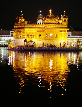 Nightly view of Golden Temple - Sikhs holy place in Amritsar - India photo