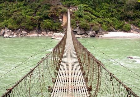rope hanging suspension bridge in Nepal photo