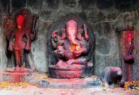 hinduist: red painted Lord Ganesha in Kathmandu during festival Stock Photo