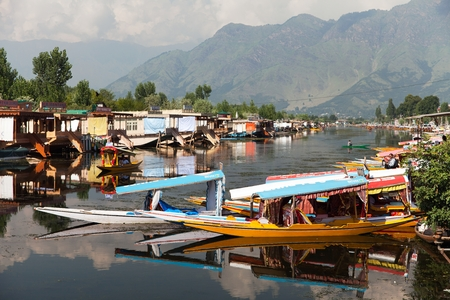 whiff: Shikara boats on Dal Lake in Srinagar, Jammu and Kashmir, India Editorial