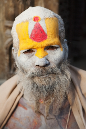 KATHMANDU, NEPAL - DEC 16, 2013 Famous painted sadhu  holy man  about Pashupatinath - 16th of december 2013, Kathmandu, Nepal