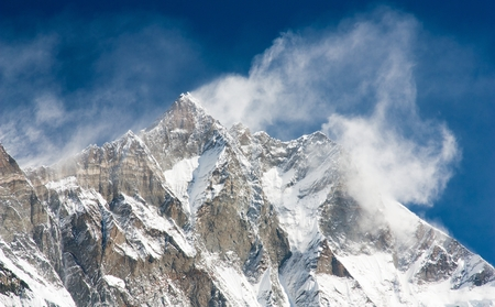 windstorm: top of Lhotse and Nuptse with windstorm and snow clouds on the top Stock Photo