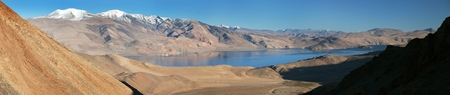 panoramic view of Tso Moriri lake, Korzok village and mounts Chamser Kangri and Lungser Kangri - Rupshu valley - Ladakh - India - The lake is at an altitude of 4 595 m photo
