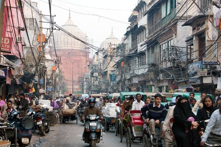 electric avenue: INDIA, OLD DELHI, 5th of December 2010 - Overcrowded street in old town with smog, dangerous electric lines and Jama masjid Editorial