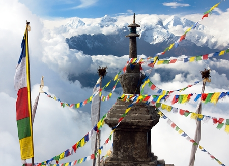 white flag: view from Langtang to Ganesh Himal with stupa and prayer flags and beautiful clouds - Nepal