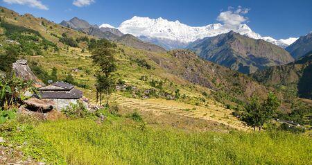 nepali: Beautiful village in western Nepal with Dhaulagiri Himal