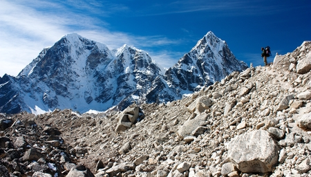 hiker on mountains - hiking in Nepal - way to everest base camp photo