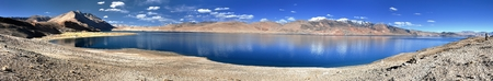 highlands region: panoramic view of Tso Moriri lake, Korzok village and mounts Chamser Kangri and Lungser Kangri - Rupshu valley - Ladakh - India - The lake is at an altitude of 4 595 m
