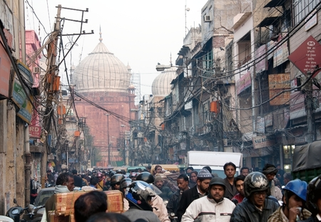 overcrowded: INDIA, OLD DELHI, 5th of December 2010 - Overcrowded street in old town with smog, dangerous electric lines and Jama masjid Editorial