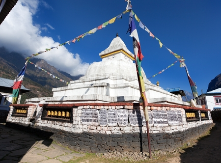 bazar: Stupa with prayer flags on the way from Lukla to Namche bazar in chaurikharka near chheplung village - nepal